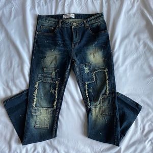 Mid Wash Patch Jeans with Paint Splatters